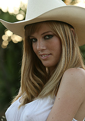 Cowgirl Boots And A Cowgirl Hat Ashley Loves To Show Off That Wonderful Body Of Hers - Picture 3