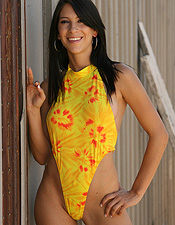 Cassie Channels The Sun Gods In Her Hot Yellow And Orange One Piece - Picture 10