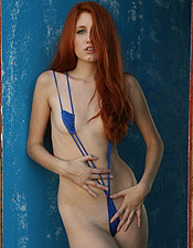Sexy Redhead Babe Posing In A Little Bikini - Picture 1
